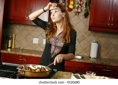 Weary cook preparing meal on gas stove with colorful vegetables.