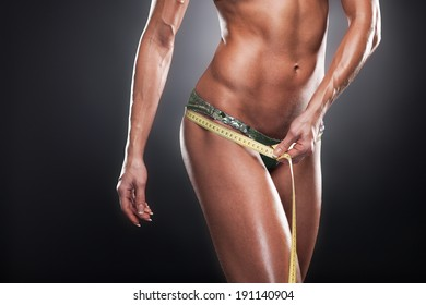 Weasuring of hips. Woman measuring perfect shape of beautiful hips
