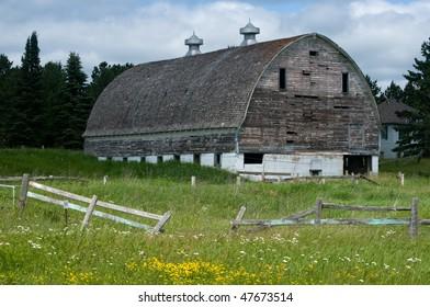 weather beaten white wooden barn near Hinkley Minnesota