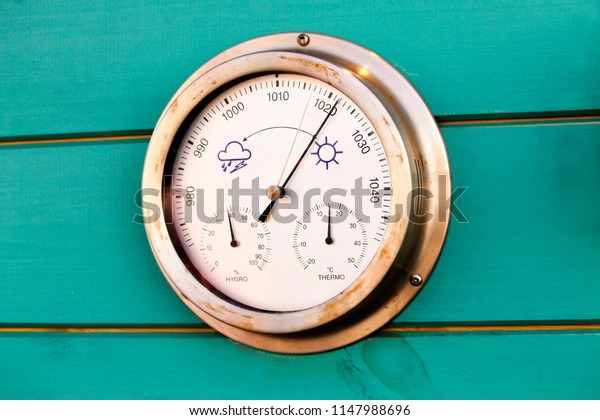Weather dial on the wall