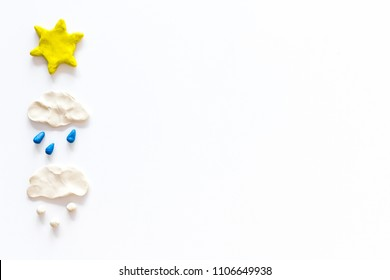 Weather forecast concept. Modern weather icons set on white background top view copy space - Shutterstock ID 1106649938