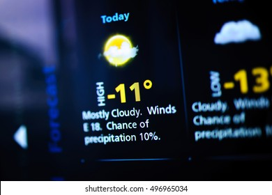 Weather forecast interface on a modern digital display showing cold weather for the next days. Tilt-shift lens used to outline the cold -13 symbols. - Shutterstock ID 496965034