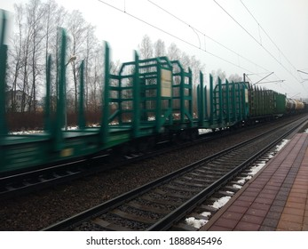 weather freight railroad train passing blurred motion background.belarus, minsk, 2021