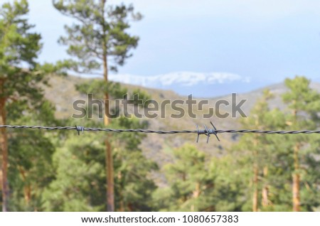 Weather In Guadarrama Mountain Range Madrid Spain Forefront Of Barbed Wire