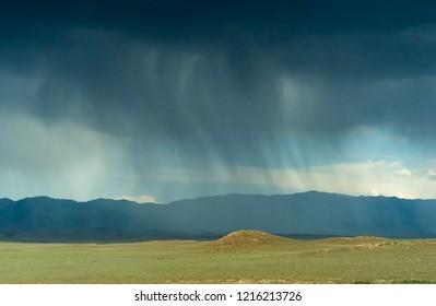 Weather Phenomenon - Water Evaporation under dark sky in National Park