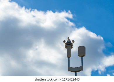 Weather station before blue sky with clouds