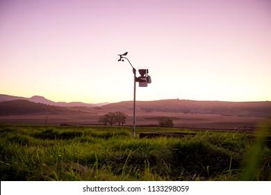 Weather station in field on farm - Shutterstock ID 1133298059