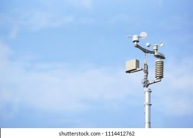 Weather station on blue sky background