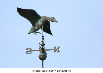 Weather vane flying duck