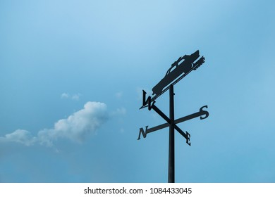 Weather vane on blue sky background