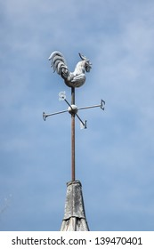 Weather vane on the top of a house, in Bois le roi, France