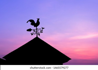 A weather vane, wind vane on the highest point of a building.
