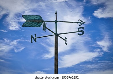 weather vanes with letters indicating the points of the compass