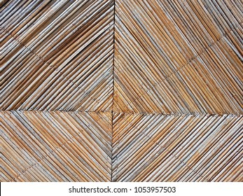 weather wood  slats mounted on a sunlit wall.