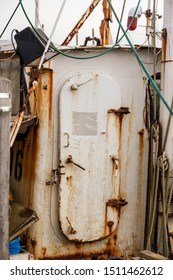 Weatherbeaten hatch on dilapidated fishing boat docked in New Bedford harbor