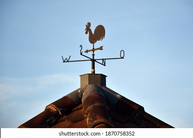 Weathercock on a house gable