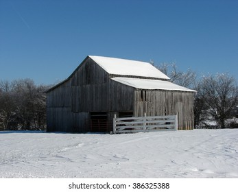 weathered abandoned building in winter snow gray barn
