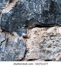 Weathered antique old cracked stone blocks wall retro background