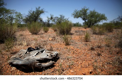 Weathered backpack left behind by a migrant in the Sonoran Desert between the USA and Mexico