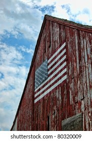 A weathered barn with an American flag. Litchfield, Connecticut.