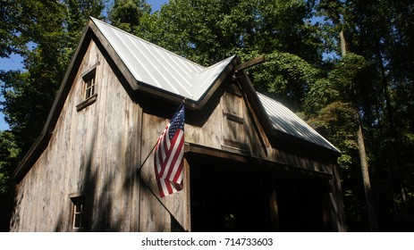Weathered Barn with American Flag in Woods Up Close Corner - Horizontal
