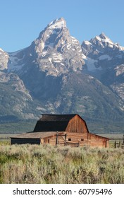 A weathered barn sits against the backdrop of the Grand Tetons in Wyoming