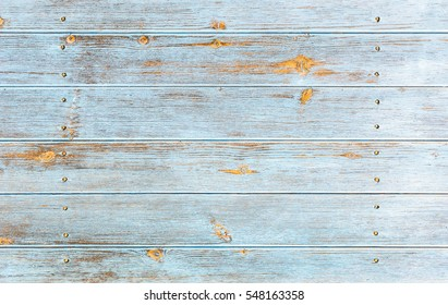 Weathered blue wooden background texture.