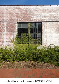 Weathered Brick Building with Window