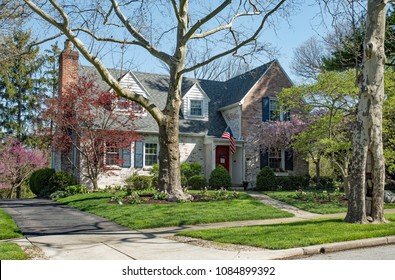 Weathered Brick House in Spring Trees Setting