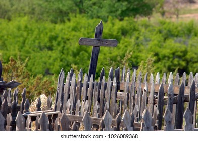 Weathered and broken, wooden crosses still stand in an old cemetery on the grounds of El Rancho del las Golondrinas near Santa Fe, New Mexico.