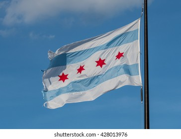 Weathered Chicago Flag Waving against blue sky