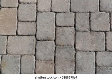 Weathered Cobblestone Brick Sidewalk.