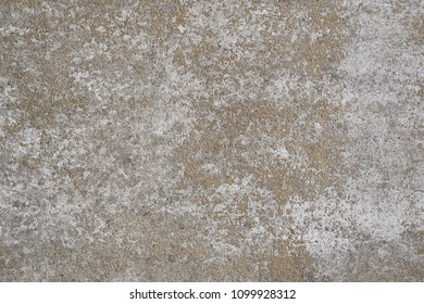 weathered concrete stone wall background texture pattern with white paint mostly peeled off