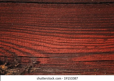 Weathered dark painted plank close-up