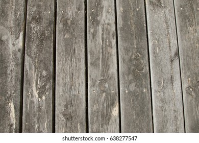Weathered deck boards on a sunny day