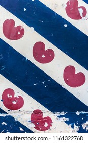 Weathered Dutch Frisian flag on a steel background