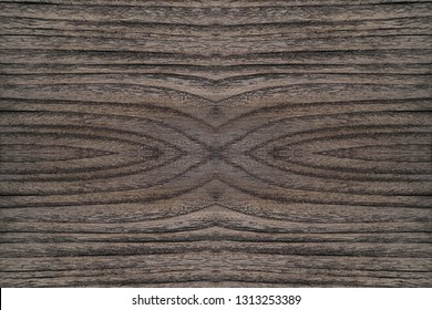 weathered ebony wood panel, concentric grain pattern