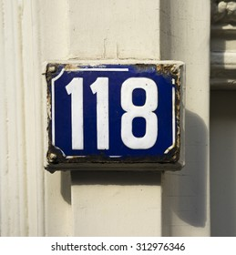 Weathered enameled house number one hundred and eighteen