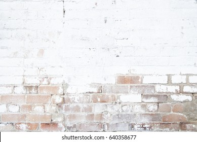 weathered exposed brick wall, white old paint background
