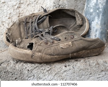 Weathered forgotten shoes