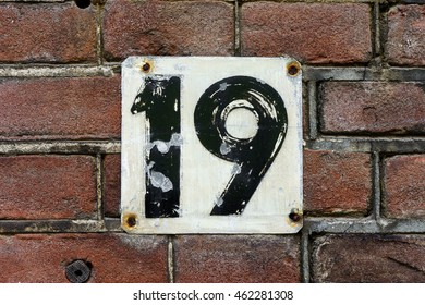 weathered hand painted house number nineteen