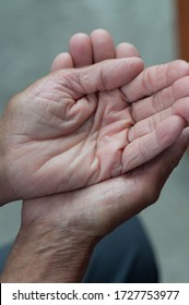Weathered hands in pose of charity