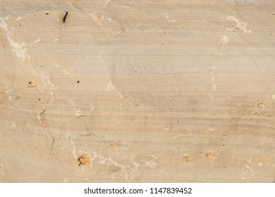 Weathered limestone rock face geology wallpaper background, showing sedimentary geologiccal strata