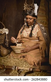 Weathered mature tribal female storyteller talking about heroic times