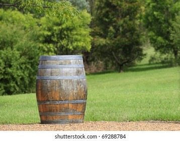 A weathered old barrel with a green garden background. Focus on foreground with room on the barrel for your text