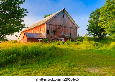 Weathered old red barn in a rural setting, Stowe, Vermont, USA