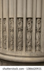 Weathered and old stone carvings decorating an edifice closeup abstract texture background.