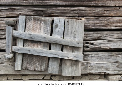 Weathered old wooden shutters window in abandoned barn in Great Smoky National Park