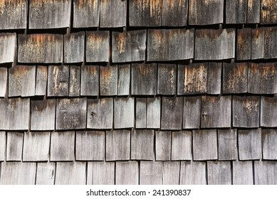 Weathered old wooden wall of shingles