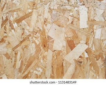Weathered Oriented Strand Board. OSB. Flakeboard. Sterling board. Aspenite. Wood grain texture. Horizontal detail.